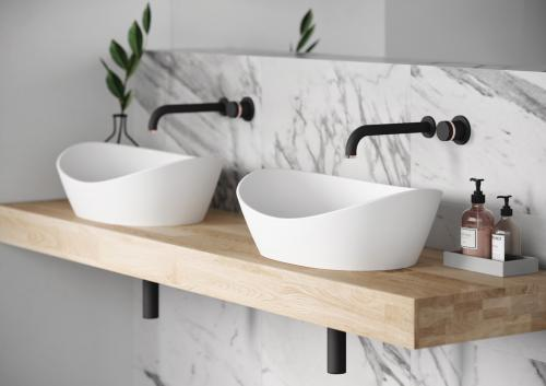 PAA Silkstone washbasin Amore on top of OAK surface and Giulini MY RING mixers from the wall
